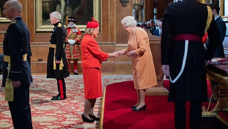 Penny Snell receives her CBE from Her Majesty The Queen
